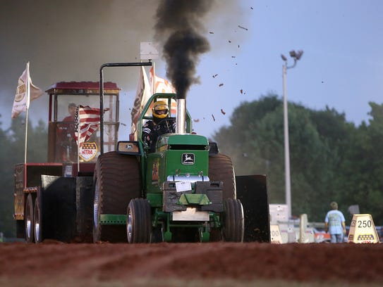 Jed Pettus pilots the Dixie Deere during the 45th Annual