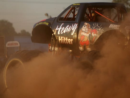 Dust flies up from the Heavy Hitter moster truck during