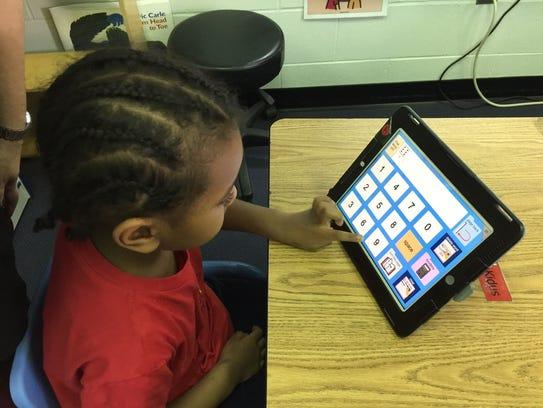 A student uses an iPad at Cedar Chapel Special School