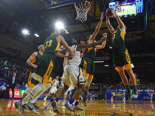 NDSU's Paul Miller (2) gets a rebound during a game