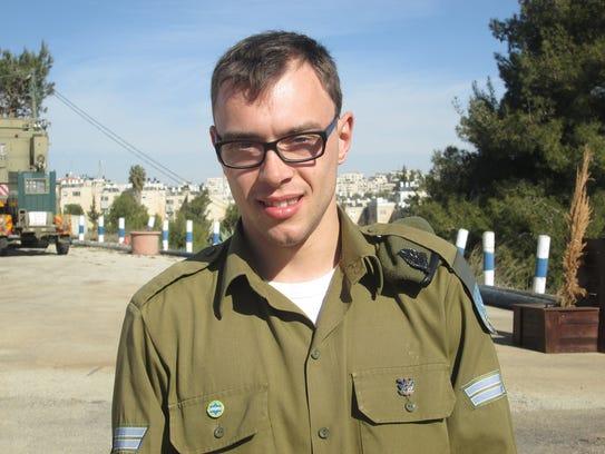 Cpl. Vladislav Polivoda, who serves as assistant to