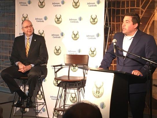 Milwaukee Bucks president Peter Feigin (right) and