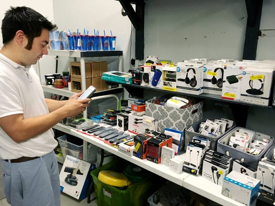 Shivoo owners Josh Perona checks out some of the new