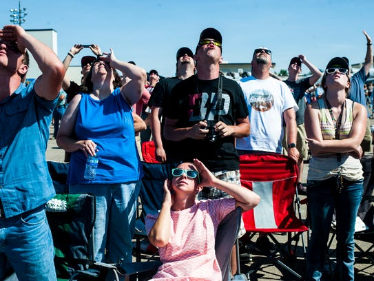 Samantha Weaver, center, watches the Thunderbirds with