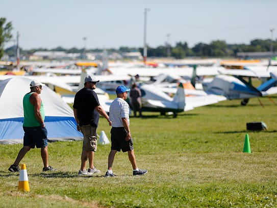AirVenture visitors make their way across the grounds