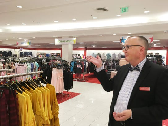 Store manager Stephen Holman shows off new Backstage
