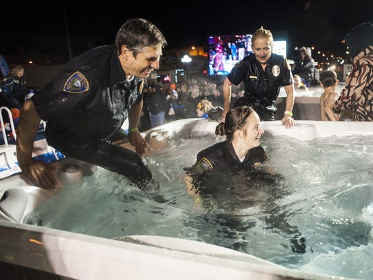 """""""Cops and Bobbers"""" teammates jump in the hot tub after"""