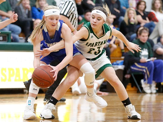 Laconia's Harper Wurtz attempts to steal the ball from Amherst's Grace Moe on Thursday.
