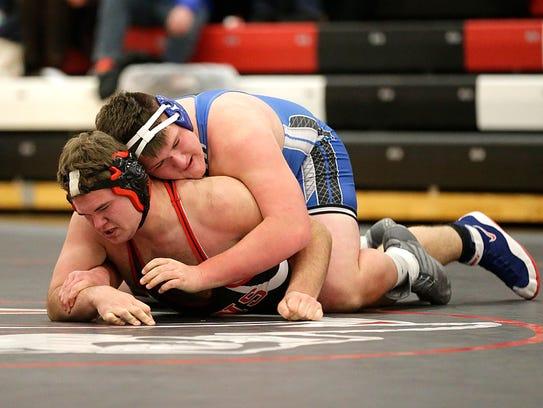 Lomira wrestler Luke Henckel takes on Winnebago Lutheran Academy's Ryan Jacob in the 285-pound weight class Dec. 7.