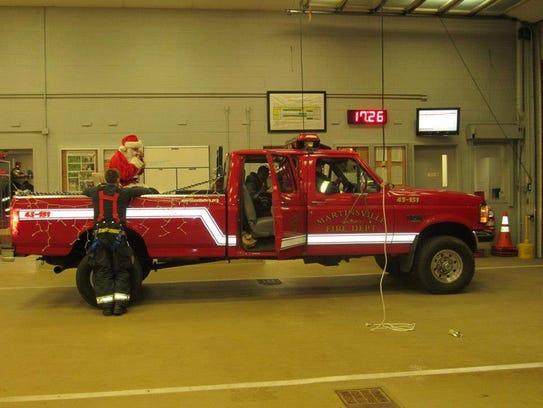 On a firetruck of the Martinsville Volunteer Fire Department,