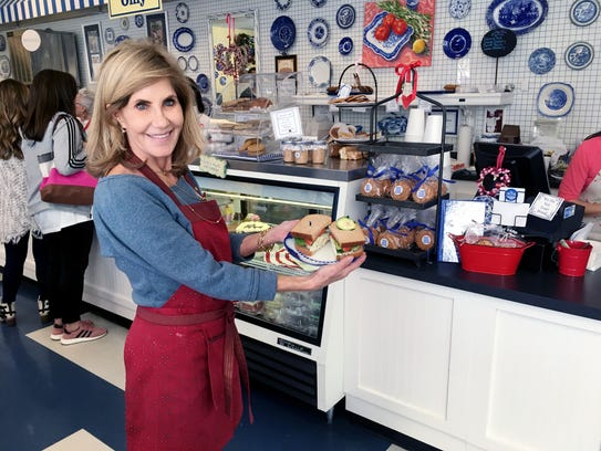 The Picnic Cafe owner Kathy Bonnet shows off a chicken salad sandwich in her restaurant which will celebrate 35 years in business in March.