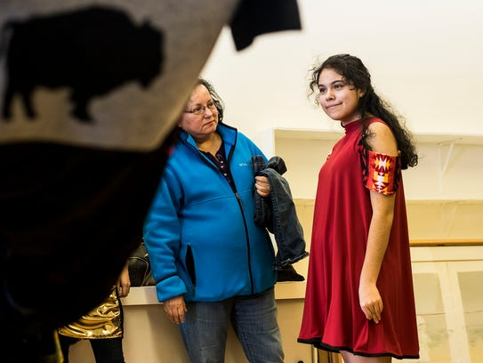 14-year-old Keeley RunningCrane wore a red dress at the March High Noon Indigenous Fashion Show in Great Falls. In Canada, red symbolizes missing indigenous women who can no longer tell their own stories.