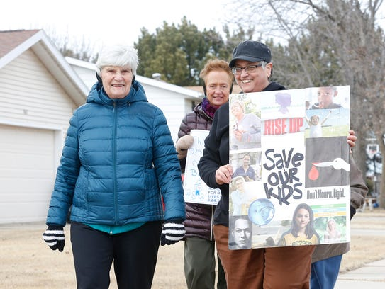 Jean Steffes, Rhea Emmer and Alice Pfeifer of Fond du Lac were part of several dozen people Saturday who participated in the Marian University March For Our Lives event.