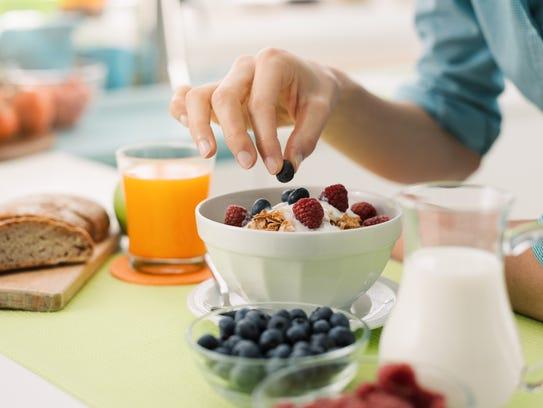 Add berries or fruit to plain yogurt for added sweetness.
