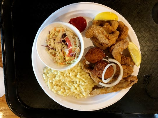 Cool Cafe is known for its Southern food, like this large serving of fried catfish, fried corn and coleslaw.