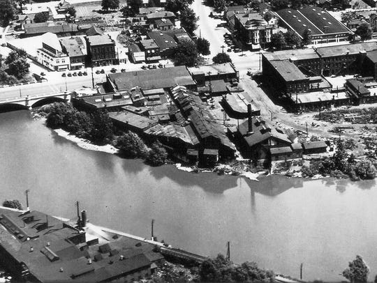 This aerial photo from around 1930, looking north across