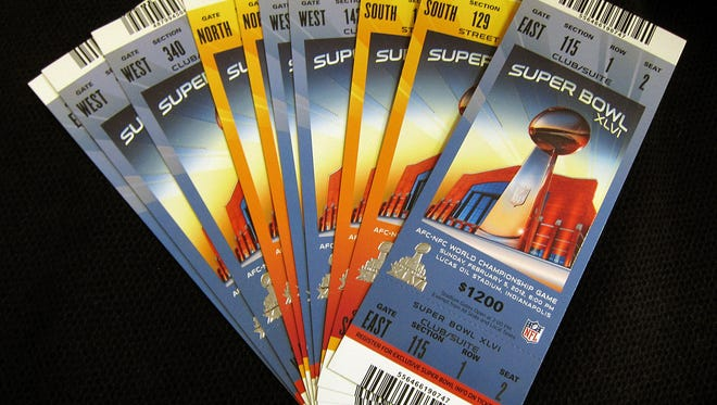 Super Bowl tickets are shown in Indianapolis, Ind., Tuesday, Jan. 24, 2012. The Super Bowl XLVI NFL football game between the New England Patriots and New York Giants takes place on Feb. 5, 2012 in Indianapolis.