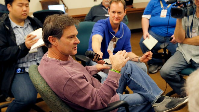 Dodgers manager Don Mattingly speaks to reporters as the club reports to spring training.
