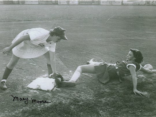 Mary Moore (left) played infield for the Battle Creek Belles of the All-American Girls Professional Baseball League from 1951-52.