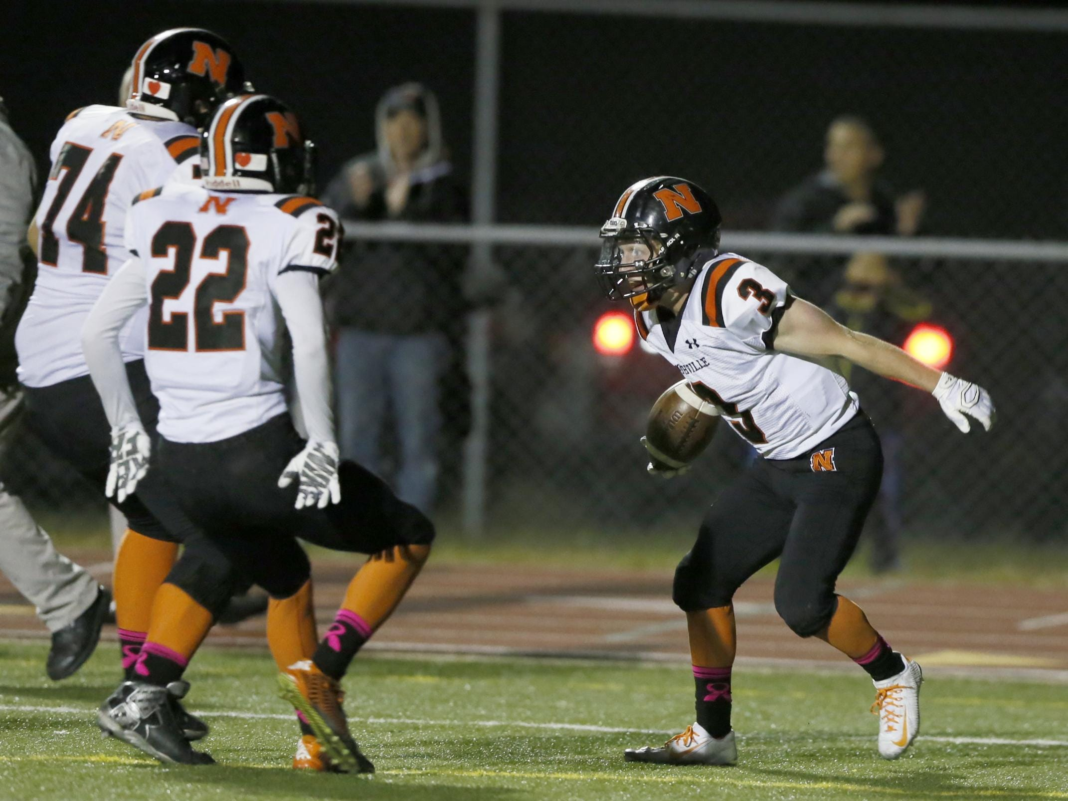 Northville's Zachary Prystash, right, gets ready to jump into the arms of his teammates after scoring to give the Mustangs a 17-14 lead.