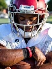 Muskegon quarterback Kalil Pimpleton holds firmly onto