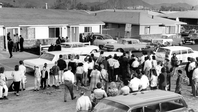 Crowds gather at the Yori Street home grisly 1963 murder scene of Sonja McCaskie.