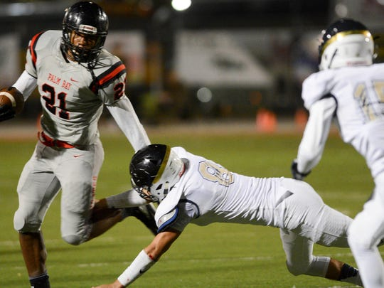 Palm Bay's BJ Daniels runs the ball during a 2016 playoff