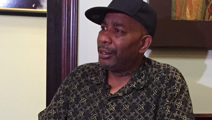 Herman Turner, Raynette Turner's husband, speaks at