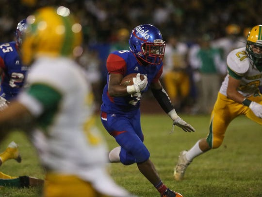 Indio's Donte Nathaniel carries the ball for a first down against Coachella Valley in the 2nd quarter on Friday, September 15, 2017 in Indio, during the annual bell game with Coachella Valley