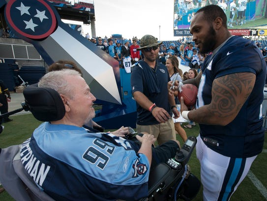 Titans defensive tackle Jurrell Casey, right, visits