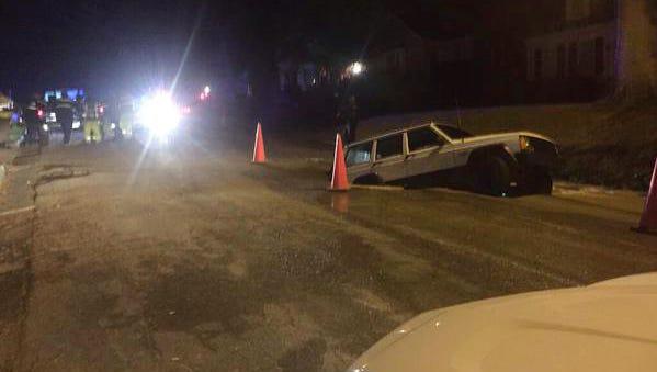Jeep Cherokee swallowed by sinkhole on Jackson's Belhaven neighborhood