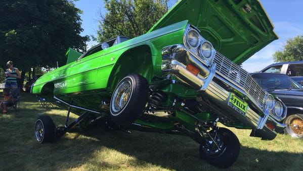 At the Dream Cruise in Pontiac, Eric Nelson brought his 1964 Chevrolet Impala with added hydraulics, chrome parts and new lime-green paint.