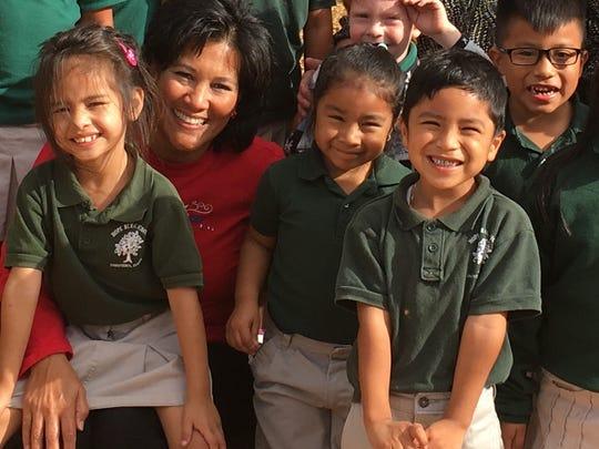 Carol Houwaart-Diez with students from Hope Rural School in Indiantown.