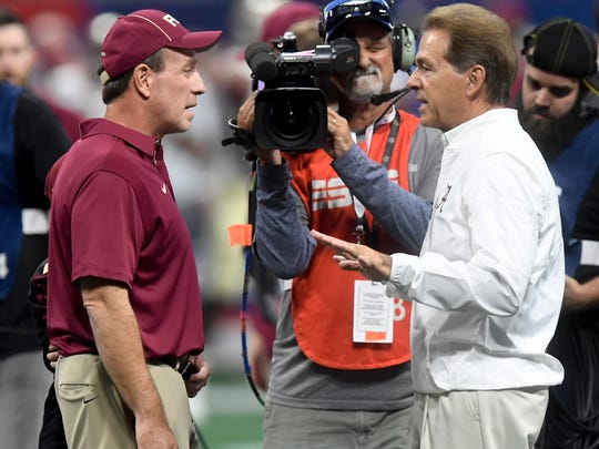 Florida State head coach Jimbo Fisher and Alabama head coach Nick Saban meet at midfield as Alabama warms up before the Chick-fil-a Classic at the Mercedes - Benz Stadium in Atlanta, Ga., on Saturday September 2, 2017.