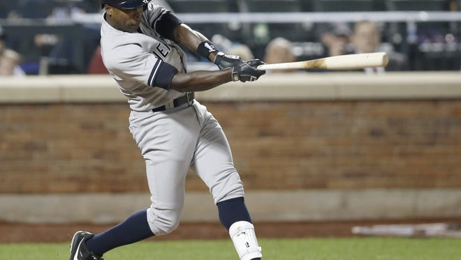 The Yankees' Alfonso Soriano drives a seventh-inning run-scoring double deep to left-center Thursday night against the Mets for the game's only run.