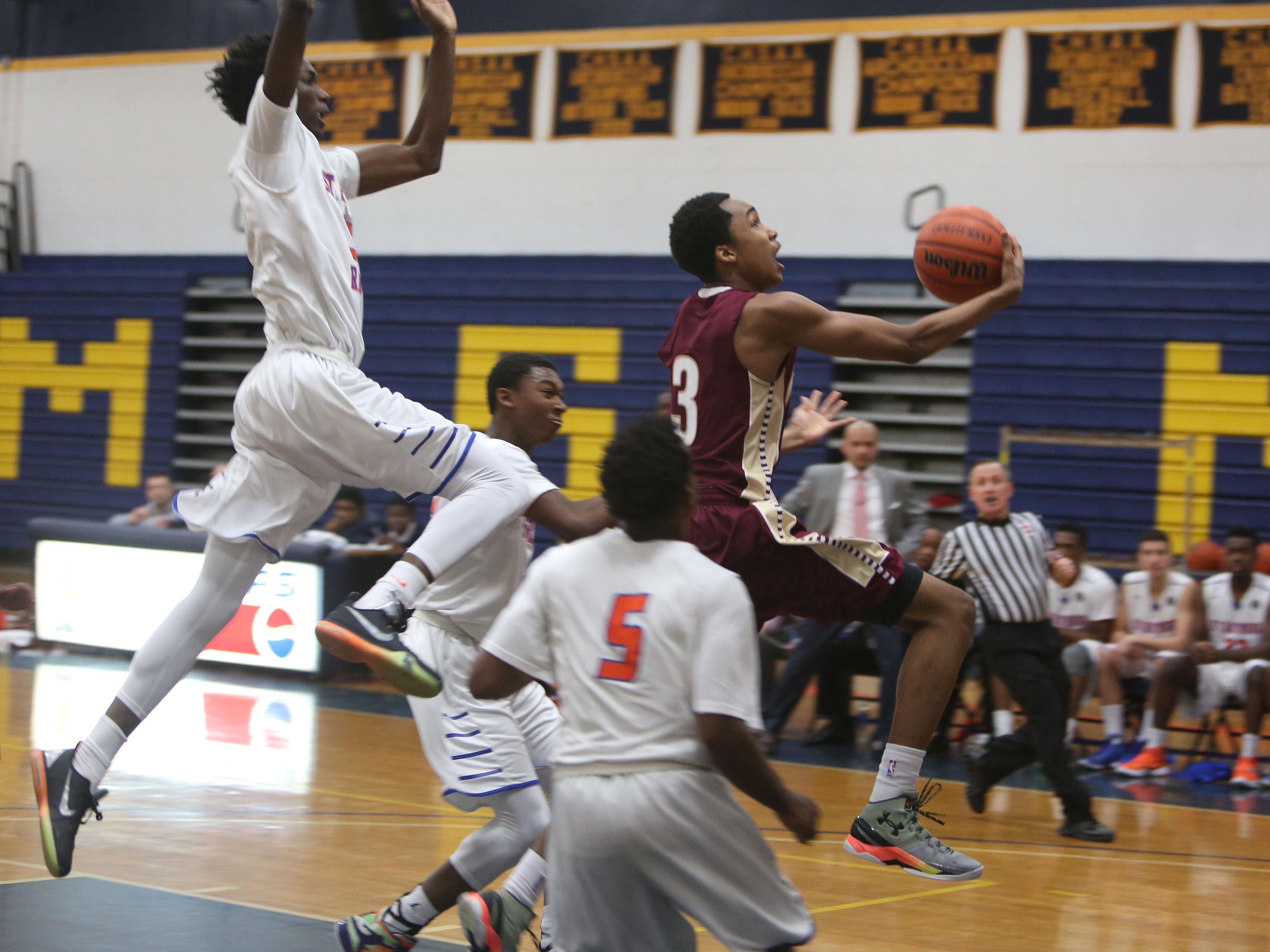 Iona's Bryce Wills (3) drives to the basket against Saint Raymond in CHSAA Archdiocesan tournament semifinal at Mount Saint Michael Academy in the Bronx Feb. 23, 2016. Saint Raymond won the game 55-47.
