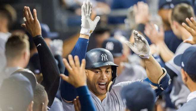 Aug 7, 2018; Chicago, IL, USA; New York Yankees right fielder Giancarlo Stanton (27) celebrates his two run home run during the tenth inning against the Chicago White Sox at Guaranteed Rate Field.