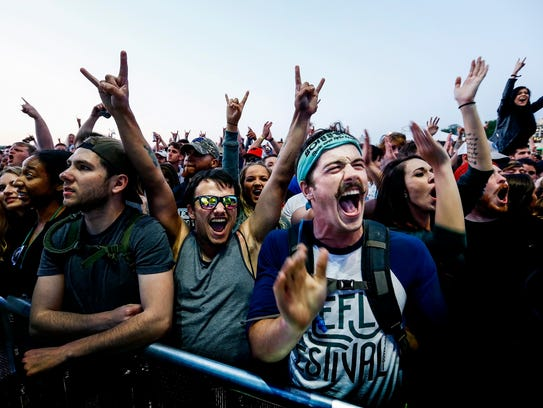 Sum 41 fans enjoy the sounds at the FedEx Stage during