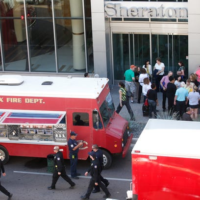 The Phoenix Fire Department evacuates the Sheraton