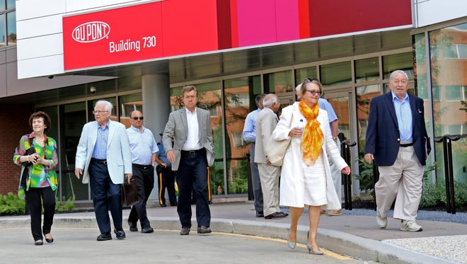 Shareholders leave the DuPont meeting that voted to approve the DuPont-Dow merger on Wednesday morning.