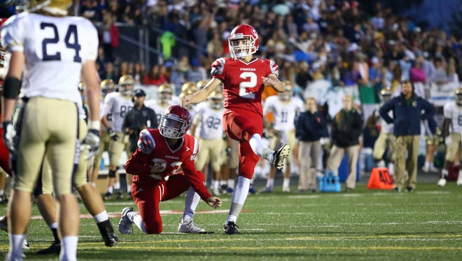 Fishers kicker Ben Norton hits one of his two field goals in the Tigers' 27-17 win over Cathedral.