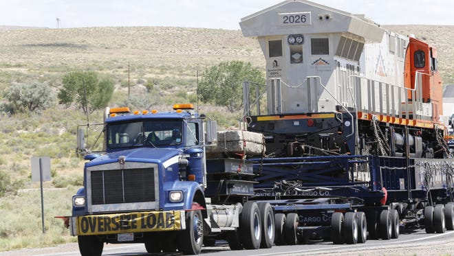 A a new locomotive purchased by the Navajo Transitional Energy Company makes its way down N.M. Highway 371 near Lake Valley on Wednesday.