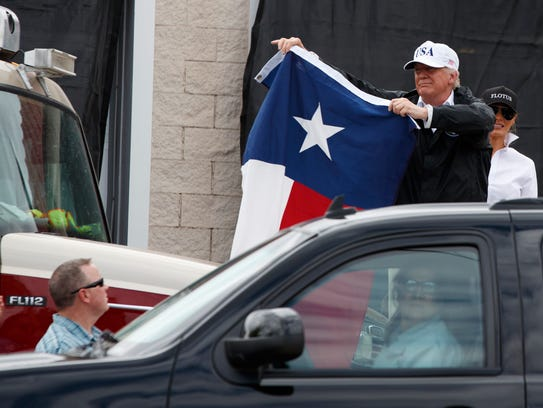 President Donald Trump, accompanied by first lady Melania