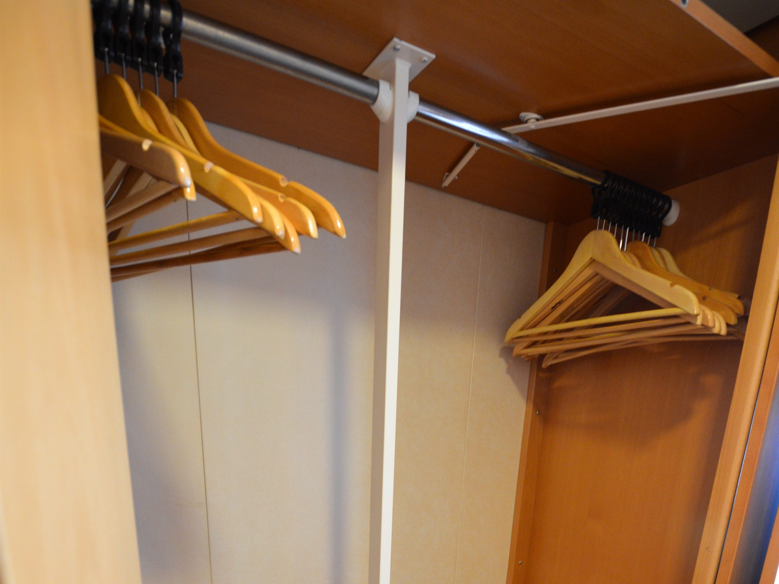 Closets in Ocean View cabins have room for hanging clothes as well as shelving.
