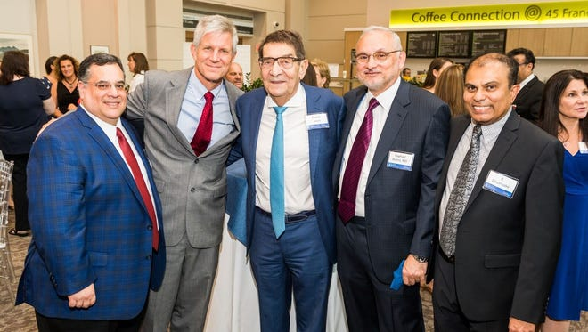 Fred Levin, center, was honored Aug. 15 at Brigham and Women's Hospital in Boston. Levin donated $2 million to the hospital to create the Fredric G. Levin Distinguished Chair in Thoracic Surgery and Lung Cancer Research.