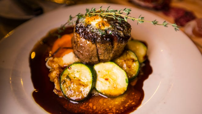 Trattoria Delia filet mignon, dripping with truffle butter on top of carrot medallions infused with thyme, zucchini and mashed potatoes.