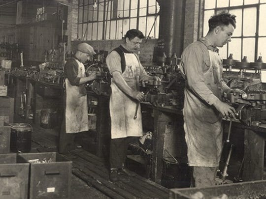 Workers at the Nineteen Hundred Corp. making washers around 1930.