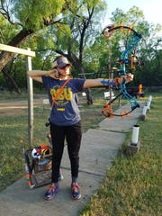 Central High School's Cie Rangel, a 16-year-old competitive archer, hopes to win scholarship money or go into competitive professional archery.