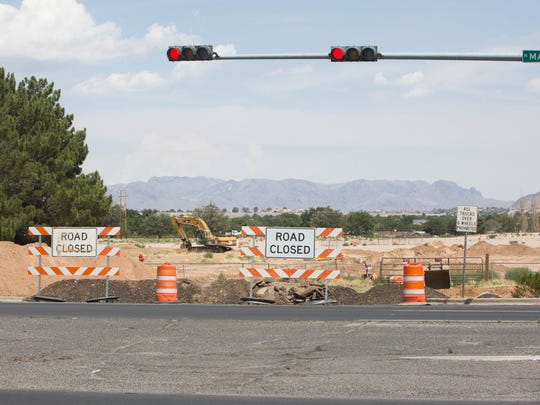 Crews work to connect city utilities to the Park Ridge development, which will allow for construction for a hospital and medical complex on the site of the old Las Cruces Country Club. Wednesday, June,7, 2017.
