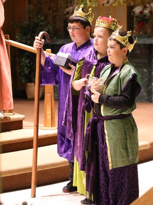 Luke Saffran, Lucas Spicer and Mason Short play the parts of the three kings during Immaculate Conception School's Christmas Pageant on Thursday evening.